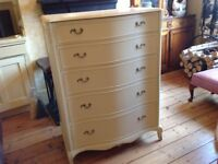 Large chest of painted mahogany drawers in creamy yellow