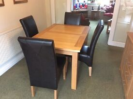 Solid oak extending table and six chairs. Excellent condition