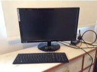 Computer monitor with keyboard