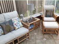 Conservatory suite in excellent condition. 2 seater settee, 2 chairs coffee table and footstool.