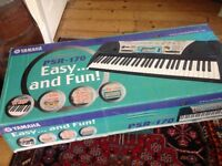 Keyboard - Yamaha PSR 170, power supply, music stand, manual and song book, original box