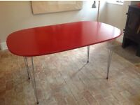 Red oval dining table metal legs seats 6
