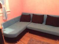 Corner sofa with sleep function