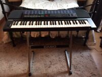 Casio keyboard with stand, dust cover, electric transformer.