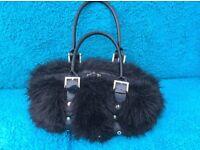 Fluffy black handbag
