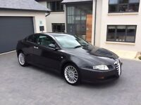 Dark grey. 2005 Alfa GT 1.9d coupe. Excellent Condition. Pale grey leather upholstery.