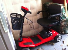 Red Liberty mobility scooter as new