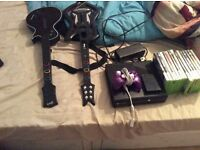 In great condition comes with 13 games and a spare memory ans one controller and 2 guitars all leads