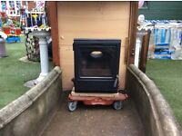 Good condition Woodburner with one glass door.