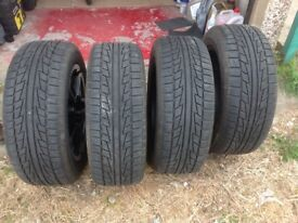ford kuga alloys with 4 almost new snow tyres on