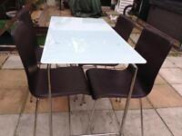 Frosted glass table L4ft W2 ft H 2ft 6ins and 4 leather look chairs