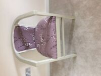 Wooden upholstered curved tub chair