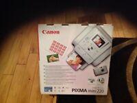 Canon PIXMA mini 220 inkjet printer.