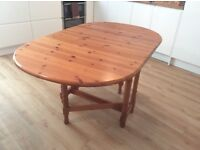 Priced for quick sale: Solid pine, drop leaf dining/kitchen table