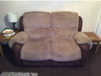 Two seater sofas recliners.