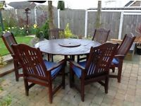 Hardwood table and chairs with cushions