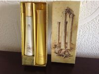 Boxed topaze perfume bottle with jewel on the top and body lotion .