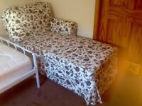 Lovely chase sofa in black and white floral print, in perfect condition