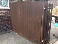 Two wooden gates with hinges and hanging pegs