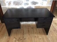 Full size black desk with three drawers and small cupboard