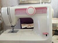 Sewing machine in perfect condition .
