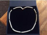Pearl necklace with Jade stone