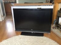 """****SOLD**** LG 42"""" LCD TV with stand."""