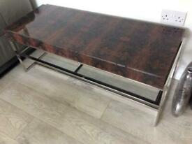 Coffee/ TV table in moulded Tortoiseshell effect glass.