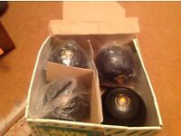Boxed set of lawn bowls.