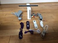 Nintendo Wii with 2 controllers and 2 nunchucks