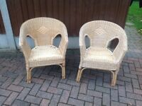 Two rattan conservatory chairs