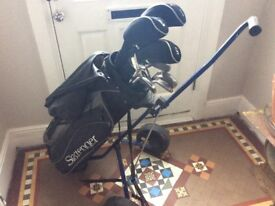 Set of Slazenger golf clubs with trolley and bag