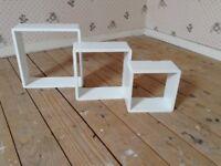 White cube shapped shelves