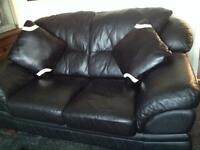 Two seater leather sofa with cushions , in good condition.
