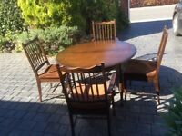 Stag round extendable table and 4 chairs