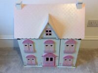 Wooden dolls house with all dolls and furniture.