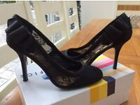 Ladies black lace high heel shoes with lovely bows on ankle size 5