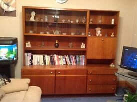 Teak. Wall unit two cupboards. Three drawers. Shelves drinks cabinet