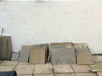 Approximately 20 sqm of Indian sandstone paving slabs in excellent condition.