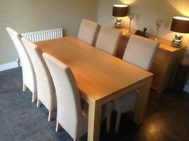 Light Oak and veneer dining table complete with six upholstered chairs