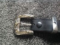 Western buckle and belt. Gold and silver style. Leather strap.
