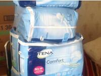 4 packets of Tena comfort pads