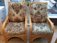 Cane sofa and two arm chairs