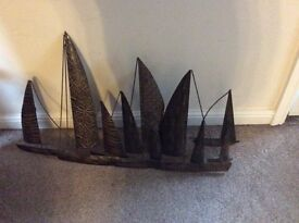 2 wall arts. Yachts 39insx24ins. Half circles 30insx26ins. £10 each. Collect Craster.