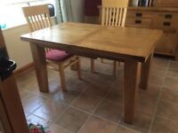 Prestige furniture pine dining room table, seats up to 8 people. In very good condition.