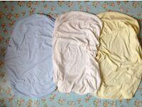 Three cotton crib sheets