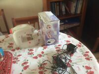 A mini sewing machine. Excellent working condition.