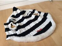 Knitted dog coat with hood.