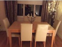 Extending table and 6 leather type chairs . Great condition sold as seen