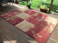 Carpet rug mainly red floral